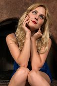 stock photo of chemise  - Beautiful tall Russian blonde in a blue chemise - JPG