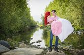 image of encounter  - Romantic Fairy Tale Couple Sitting on Rocks at River Side in Peaceful Idyllic Setting - JPG