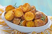 foto of baked potato  - Oven baked potatoes with rosemary in a baking dish - JPG