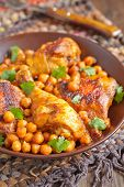 foto of curry chicken  - Curry Chicken With Chickpeas on a table - JPG