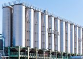 image of silos  - Detail of chemical plant silos and pipes - JPG