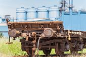 foto of wagon  - freight wagon rail with the background of the silos - JPG