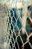 picture of chain link fence  - Steel net fence with blur background, steel net fence