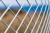 image of solid  - Solid gray metallic mesh fence protection closeup - JPG