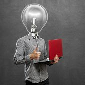 stock photo of job well done  - lamp head man with laptop in his hands shows well done - JPG
