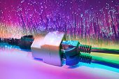 stock photo of cisco  - network cables and hub closeup with fiber optical background - JPG