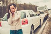 image of tow-truck  - Woman calling while tow truck picking up her car - JPG