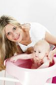 picture of bathing  - portrait of mother with her baby during bathing - JPG