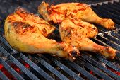 picture of bbq party  - Marinated Chicken Legs On The Hot BBQ Charcoal Grill - JPG