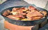 picture of veal  - Cooking of traditional balkan turkish bosnian dalmatian meal Peka in metal pots called sac sach or sache - JPG