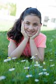 image of  preteen girls  - Happy casual preteen girl lying in the grass - JPG