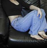 Girl On Sofa Wearing Denim Jeans
