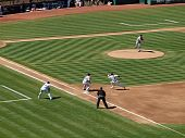 Josh Beckett Throws To 1St As Coco Crisp Runs Back To The Base