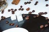 pic of sugar cube  - Sugar cubes on a vinyl plate among coffee beans - JPG