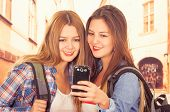 image of bff  - Cute young fashionable happy girls using cell phone taking selfie - JPG