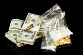 pic of heroin  - Drug syringe and heroin with pills over money - JPG