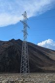 picture of voltage  - A high voltage transmission tower with electric wires - JPG