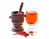 pic of infusion  - Glass healing infusion of goji berries and dried berries nearby - JPG