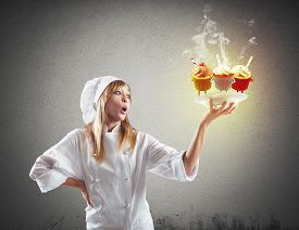 picture of pastry chef  - Chef surprised by her delicious dessert pastries - JPG
