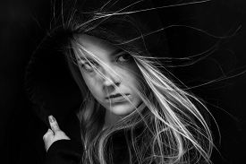foto of gothic girl  - scared girl in black hood in dark monochrome - JPG