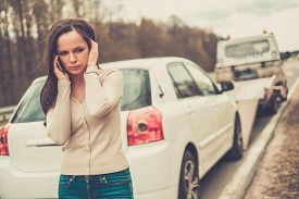 pic of towing  - Woman calling while tow truck picking up her car - JPG