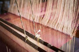 image of handloom  - Vintage manual weaving loom with unfinished textile work - JPG