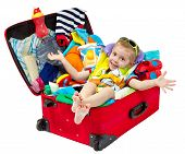 stock photo of carry-on luggage  - Little kid in travel red suitcase - JPG