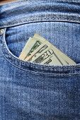picture of tuck-shop  - Twenty dollar bills tucked into jeans pocket - JPG