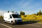 image of truck-cabin  - Clean White Van on a freeway or motorway - JPG