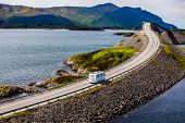 Caravan car RV travels on the highway Norway. Atlantic Ocean Road or the Atlantic Road (Atlanterhavs poster