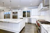 Large, Spacious Kitchen Design With White Kitchen Cabinets poster