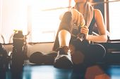 Sport Woman Sitting And Resting After Workout Or Exercise In Fitness Gym With Protein Shake Or Drink poster