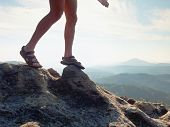 Long Tired Naked Legs In Hiking Sandals On Peak. Hiking In Sandstone Rocks, Hilly Landscape poster