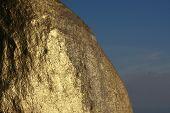 Texture of Kyaiktiyo Boulder Stupa (Golden Rock), Mon State, Myanmar (Burma).