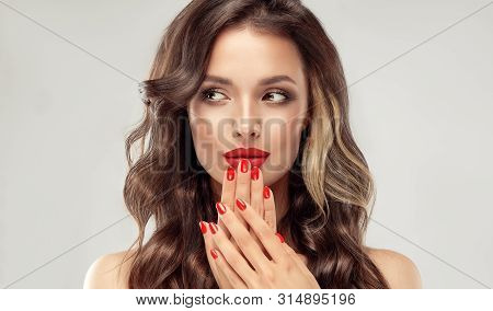 poster of Beautiful Girl  Long , Curly Hair . Model Woman Showing A Red   Manicure On Nails   . Cosmetics And