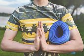 Yoga. Close Up Men Hands. Young Men Do Yoga Outdoors On Mat.guy Exercising Yoga On The Garden.young  poster