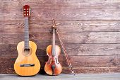 Vintage Musical Instruments And Copy Space. Retro Guitar And Violin On Wooden Background. Classical  poster
