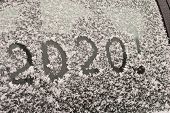 The Inscription 2020 On The Snow. The Inscription On The Glass Of The Car. The Concept Of A New Year poster