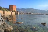 Photo Taken In Turkey. The Picture Shows The Red Tower In The Harbor Of Alanya. poster