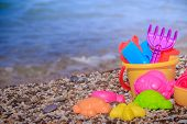 Plastic Childrens Toys For Sand On The Background Of The Sea. Kids Toys. Plastic Sand Toys. Bright T poster