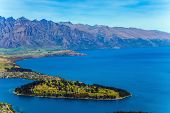 Birds eye view. The city - resort Queenstown, shores of Lake Wakatipu. Travel to New Zealand, Sout poster