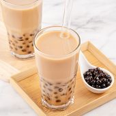 Tapioca Pearl Ball Bubble Milk Tea, Popular Taiwan Drink, In Drinking Glass With Straw On Marble Whi poster