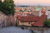 Steps Lead From The Prague Castle Down To The District Lesser Town With Pananorma View Over The Old  poster