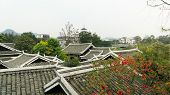 Traditional Roofs Of Buildings In China. Ancient City Yangshuo, China poster