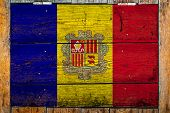 National Flag Of Andorra On A Wooden Wall Background.the Concept Of National Pride And Symbol Of The poster