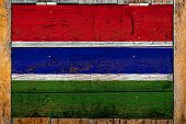 National Flag Of Gambia On A Wooden Wall Background.the Concept Of National Pride And Symbol Of The  poster