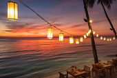 Romantic sunset on the shore of a tropical island, Koh Chang, Thailand. Outdoor cafe on the beach. poster