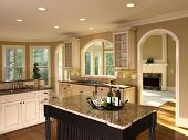 picture of model home  - Luxury Model Home with Kitchen Island arch door - JPG
