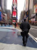 stock photo of nypd  - policeman in black uniform on Times Square New York - JPG
