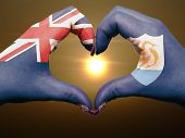Heart And Love Gesture By Hands Colored In Anguilla Flag During Beautiful Sunrise For Tourism